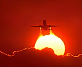 Boeing 737 taking off at sunset