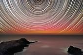 Aurora australis and star trails