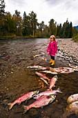Girl watching salmon spawn