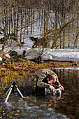 A nature photographer at work