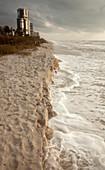 Beach erosion during a storm,Gulf Coast