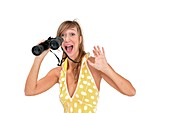 Excited woman with binocular