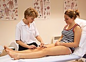 Physiotherapist assessing a patient