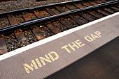 Mind the gap warning sign at rail station