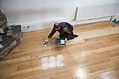 Re-varnishing a floor