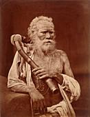Sadhu Faqir holding a pipe