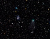 Galaxy NGC 2997 and comet C2012 V2