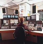 Engineer siting in front of control panel