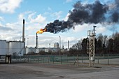 Flaming burn-off tower at oil refinery