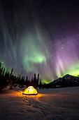 Aurora Borealis over campsite in Alaska