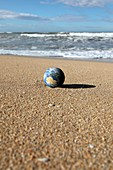 Earth on a beach,composite image