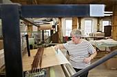 Textile mill loom operator