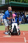 Disabled girl playing baseball