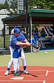Disabled boy playing baseball