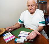 Senior man with prescription drugs