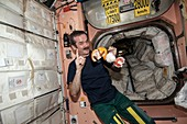 ISS astronaut with fruit