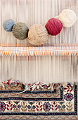 Turkish carpet being woven on a loom