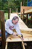 Volunteer building a wheelchair ramp