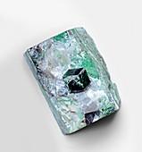 Uvarovite garnet crystal in skarn matrix