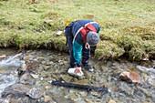Scientist emptying sediment trap