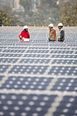 Workers at a 1 MW solar power station