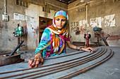 Women constructing solar cookers