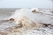 Waves crashing off Whitehaven harbour