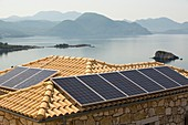 Solar panels on a house roof in Sivota