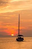 A sailing boat at sunset,Corfu