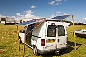 A van with solar panels attached
