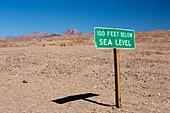 A sign at 100 feet below sea level