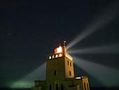 Night sky over a lighthouse