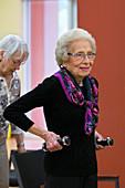 Active elderly lady exercising