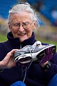 Senior athlete with sports shoe