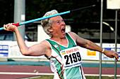 Senior female athlete throws javelin