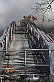 Firefighter on telescopic ladder