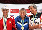 Older female athletes on medals rostrum