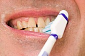 A man brushing his teeth