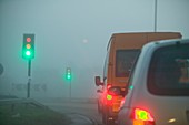 cars driving in the fog,UK