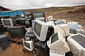 Old televisions at rubbish dump