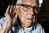 Elderly man with hearing loss