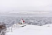 Church by a frozen lake,Iceland