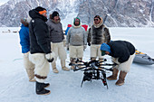 Inuit hunters with octocopter drone