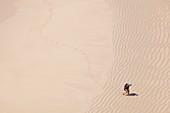 Man leaving footprints on beach