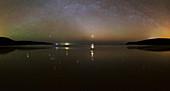 Starlight reflected in a bay at night