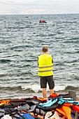 Volunteer helping Syrian refugees,Greece