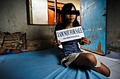 Girl with sign,Indonesia