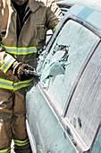 firefighters break windshield