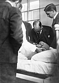 William Osler attending a patient,1900s