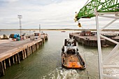 A tug boat towing a jack up barge